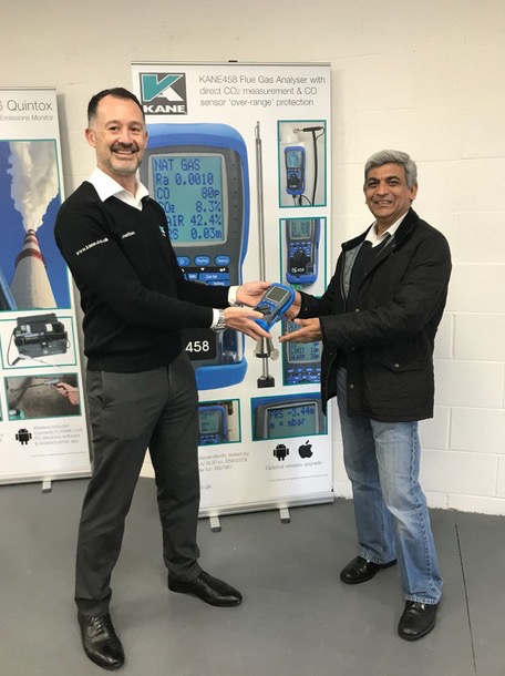 Operations Director Jonathan Hoole presets Sunil with his prize