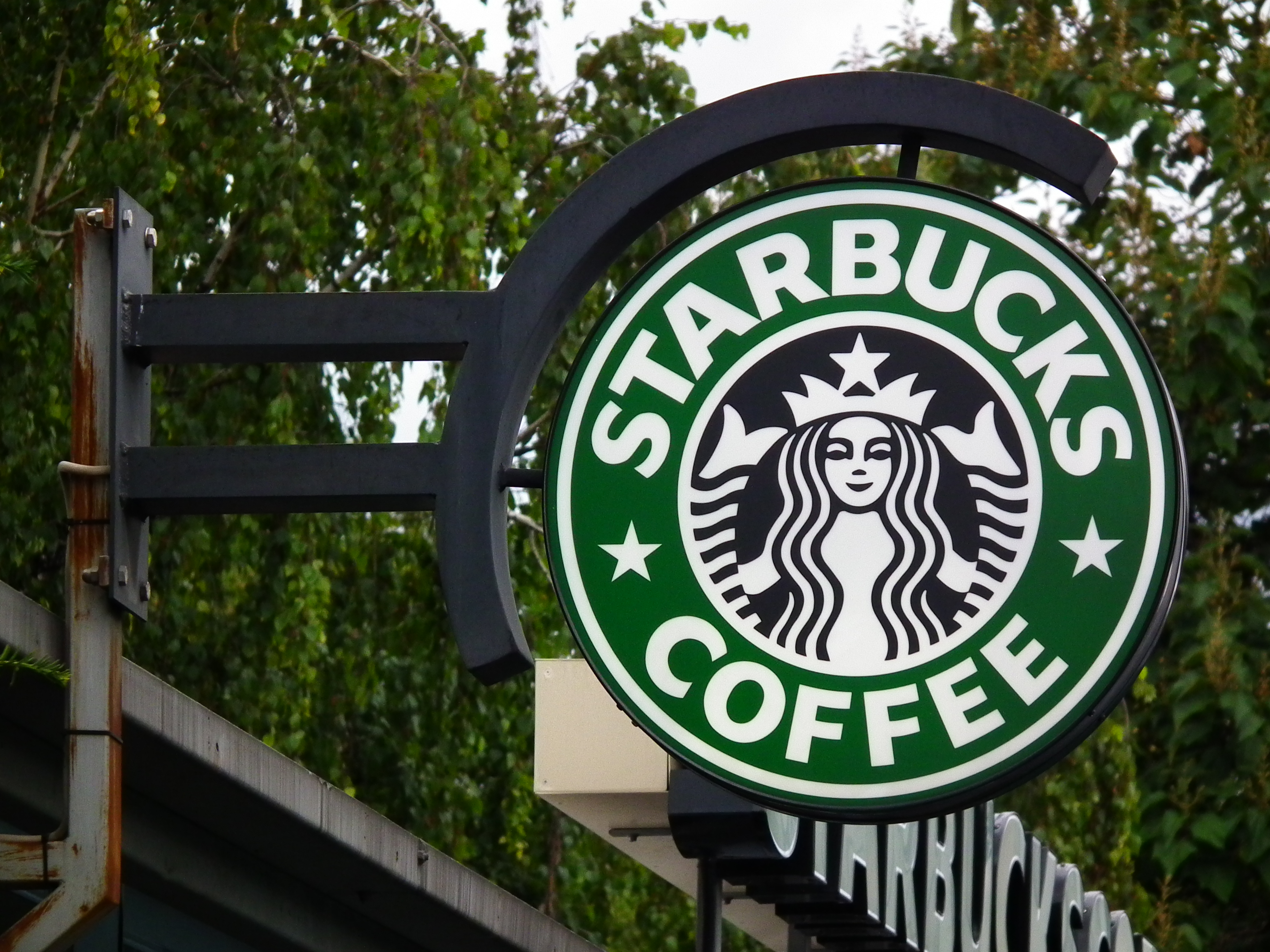 Image of a rustic Starbucks exterior sign