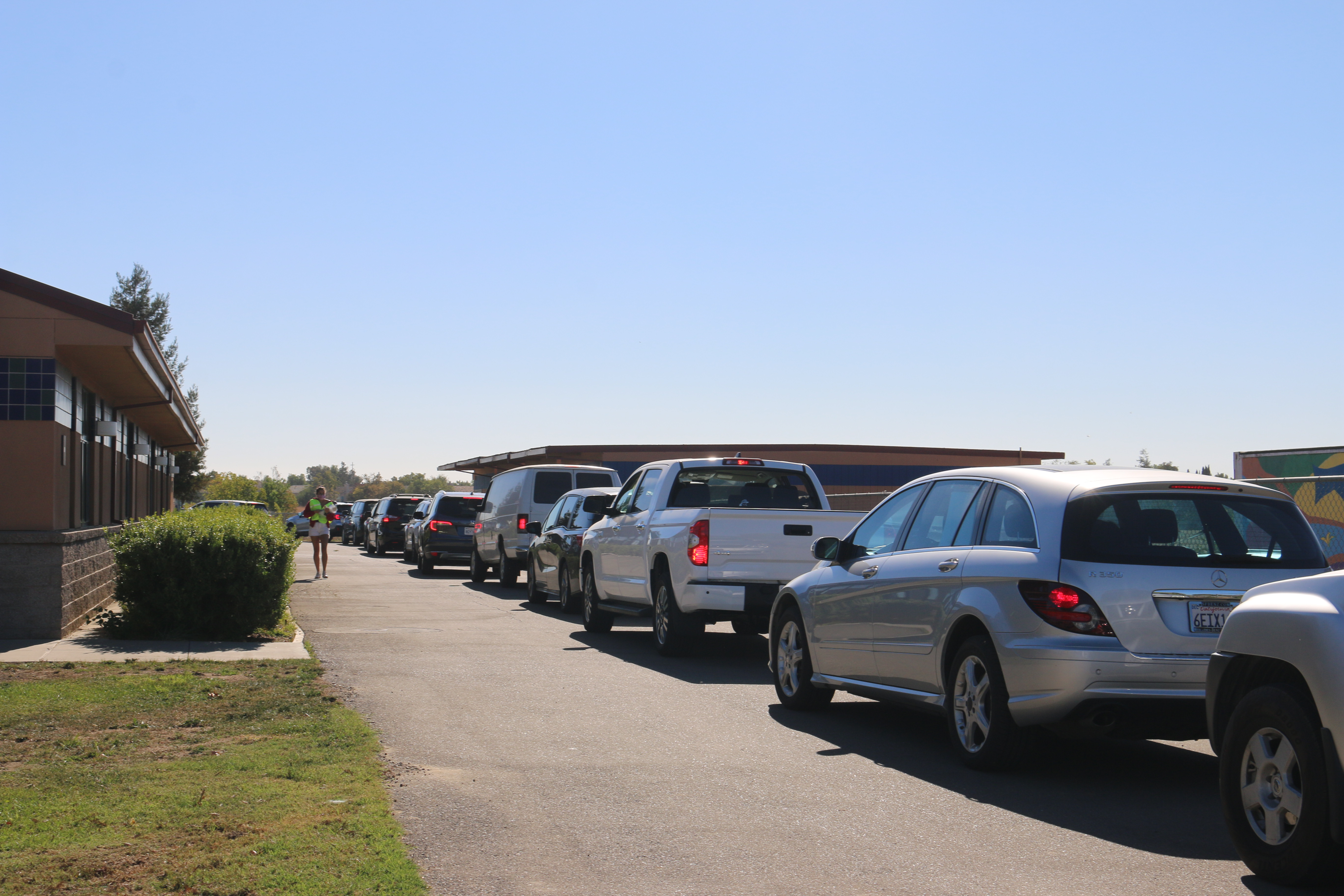 A line of cars waiting in the back of the Harper Junior High campus for the drive-thru clinic