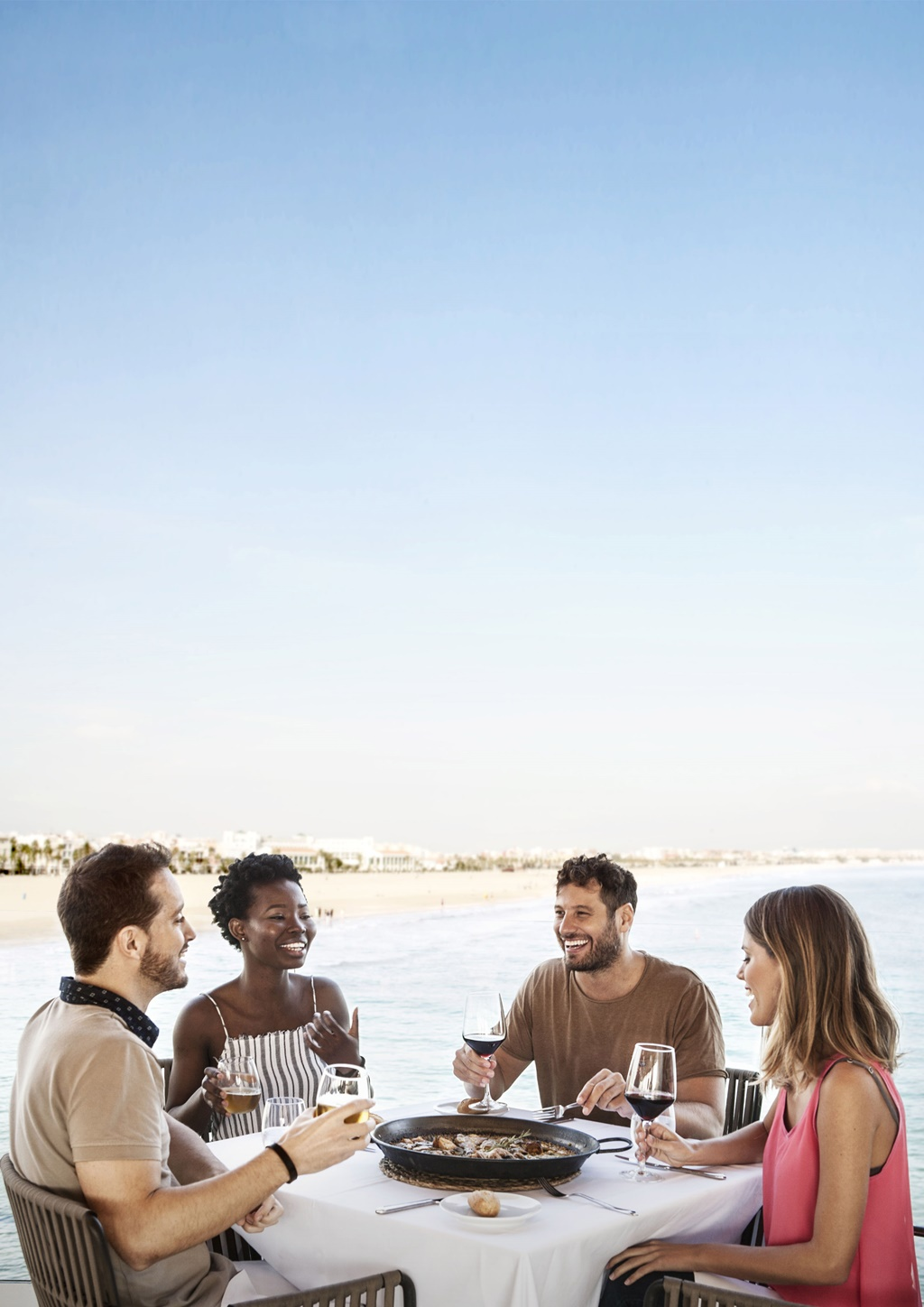 Sample an authentic Valencian paella by the sea